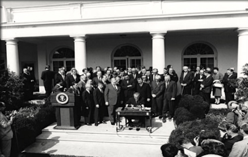 President Johnson signs the EOA