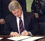 Bill Clinton signs DOMA in 1996